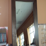 tall wooden wall mirror